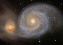 M51 and early type-companion in enhanced colors. Credit: SDSS