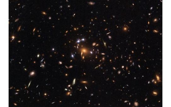 The galaxy cluster SDSS J1004+4112, discovered in the Sloan Digital Sky Survey and pictured by HST, is one of the more distant known, and is seen as it appeared when the universe was half its present age.