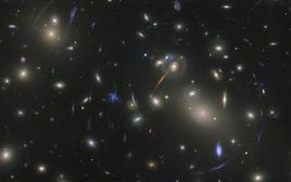 Galaxy cluster Abell 2218, with several giant gravitational arcs. Credit: NASA-HST.