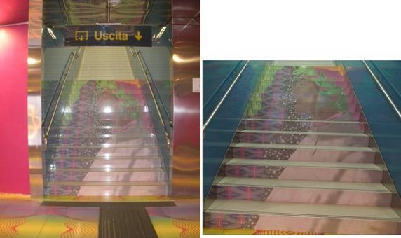 """Stazione """"Università""""  del Metrò. I pannelli colorati lungo i binari dei treni  sono stati realizzati secondo i disegni di Karim Rashid.Un omaggio alla cultura umanistica: l'immagine di Dante lungo le scale d'uscita (foto dell'a. 2012)"""