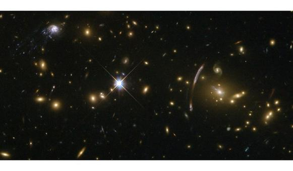 "The rich galaxy cluster Abell 2667 and the ""comet galaxy"" observed by the Hubble Space Telescope. Credit: NASA/ESA."