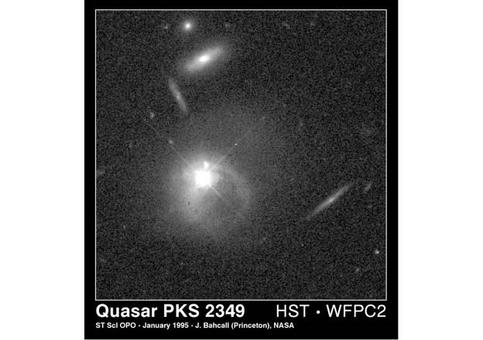 This NASA Hubble Space Telescope image shows evidence for a merger between a quasar and a companion galaxy. Credit: John Bahcall, Institute for Advanced Study, NASA.