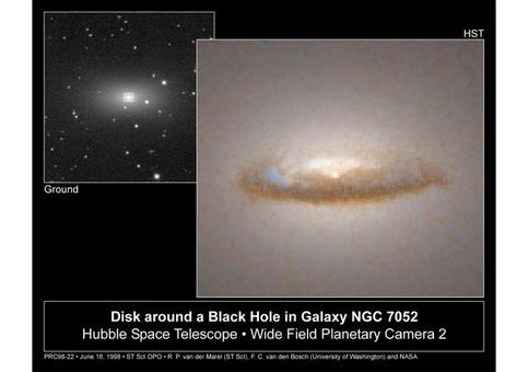 A 3,700 light-year-diameter dust disk encircles a 300 million solar-mass black hole in the center of the elliptical galaxy NGC 7052. The disk, possibly a remnant of an ancient galaxy collision, will be swallowed up by the black hole in several billion years.